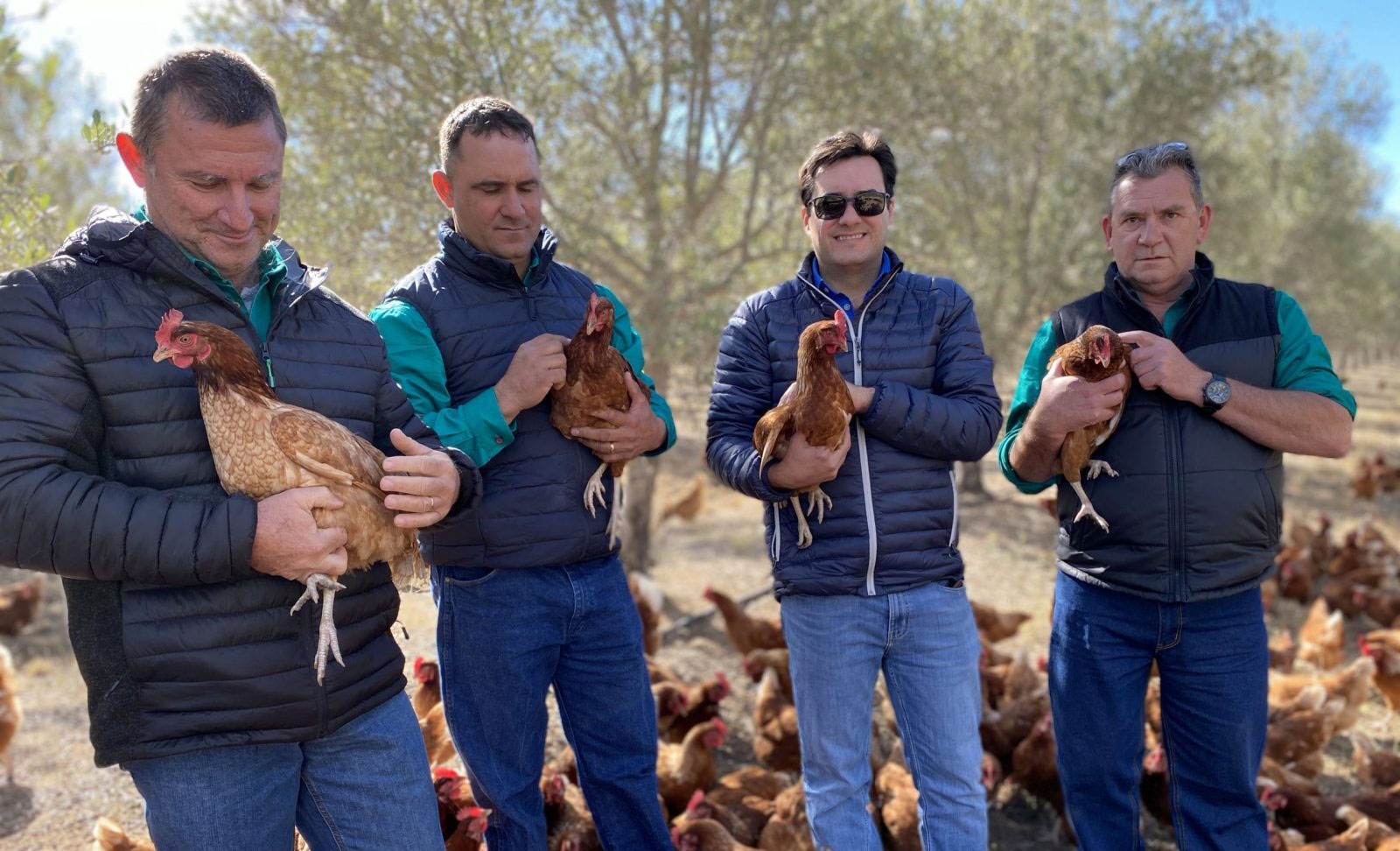 farmers holding chickens